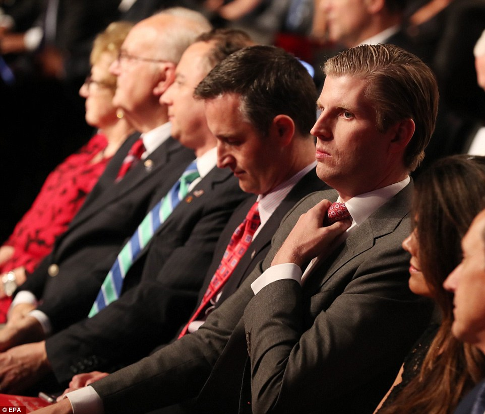 Eric Trump, son of Republican Presidential candidate Donald Trump, takes his seat in the front row before the debate s