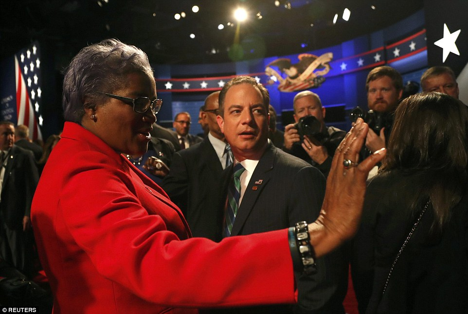 Democratic National Committee Chair Donna Brazile (left) talks with Republican National Committee Chair Reince Priebus ahead of the one and only Vice Presidential debate