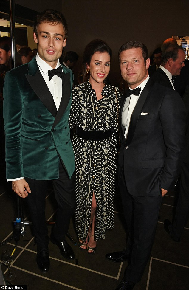 In good company: The couple cosied up to heartthrob actor Douglas Booth inside the event
