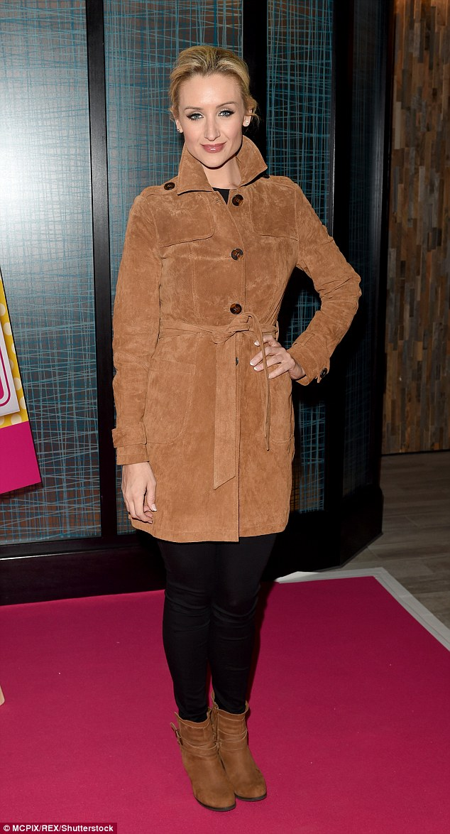 Autumnal chic: Catherine Tyldesley, 33, wrapped up in a chic suede trench coat which she belted over her slim frame