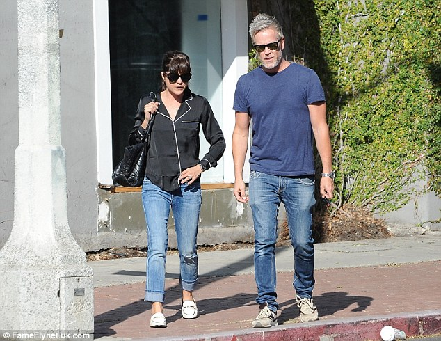 Low-key: The actress' handsome pal wore a blue t-shirt and jeans for the outing