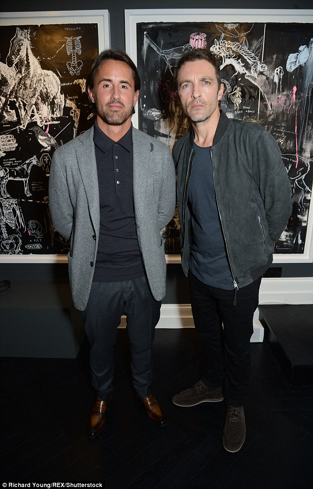 Someone got the memo: Jay Rutland posed next to handsome artist Dan Baldwin in similar outfits