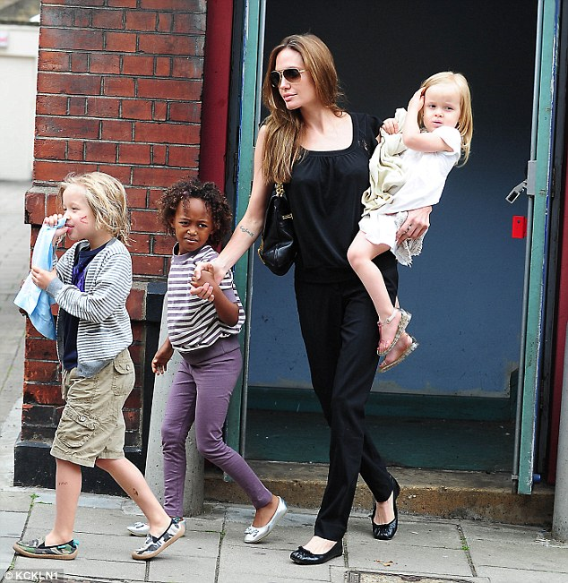 A tough time for the mom: Jolie, 41, has six children with Pitt; here she is seen with Shiloh, Zahara and Vivienne in 2011