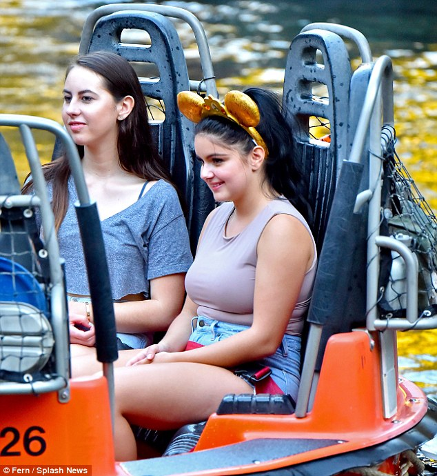 Disneyland visit: The 18-year-old flashed a smile as they tried out the Grizzly River Run ride
