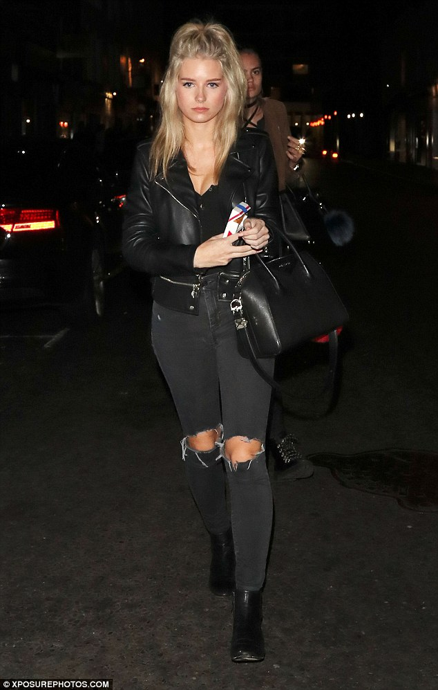 Night out: Lottie Moss, 18, looked utterly stylish in a pair of ripped jeans and leather jacket as she headed to Jak's Bar in Chelsea on Monday