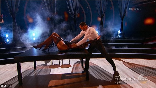 Sexy: The dance ended with Maks climbing on top of Amber on a table