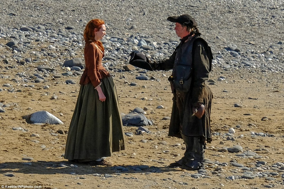 Bearer of bad news? Stood alone in the middle of the beach, Demelza was presented with a tricorn hat by the dishevelled man, which appeared to signal grief for the former servant girl, as the actress screwed her features into a grief stricken mask