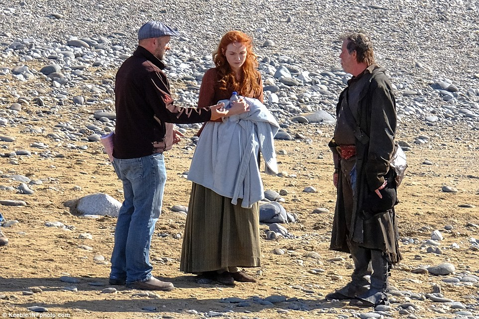 That's a wrap: Following the scene, Eleanor was handed a fluffy robe to wrap around herself - presumably to keep the bite of the wind at bay