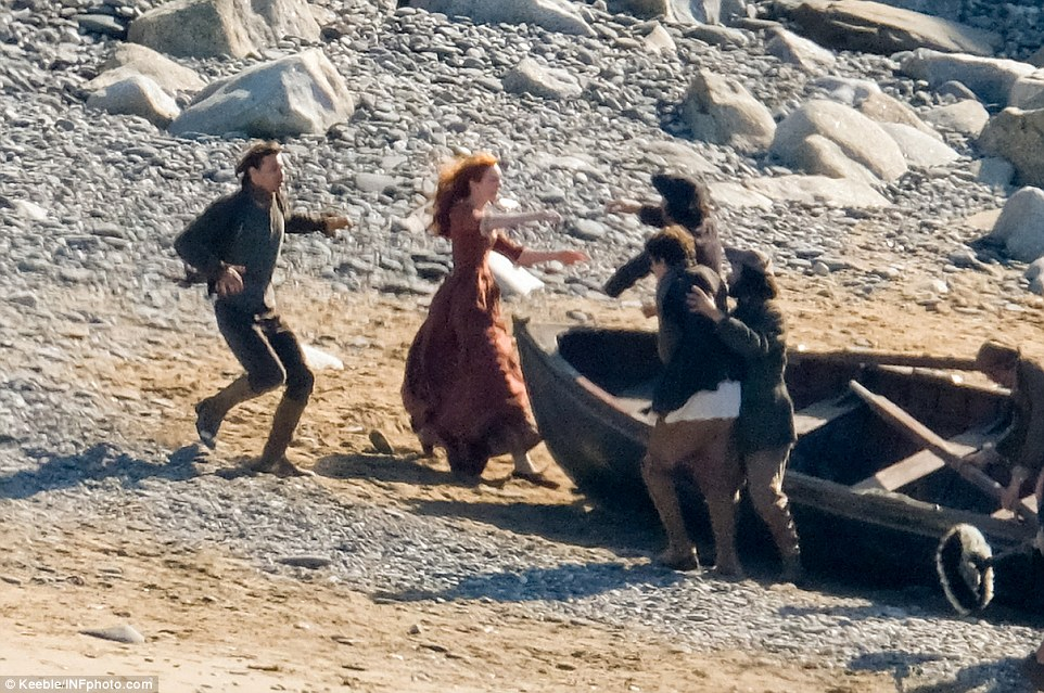 Into his arms: Eleanor ran full-pelt into Aidan's arms as he and the crew of the boat arrived back on shore