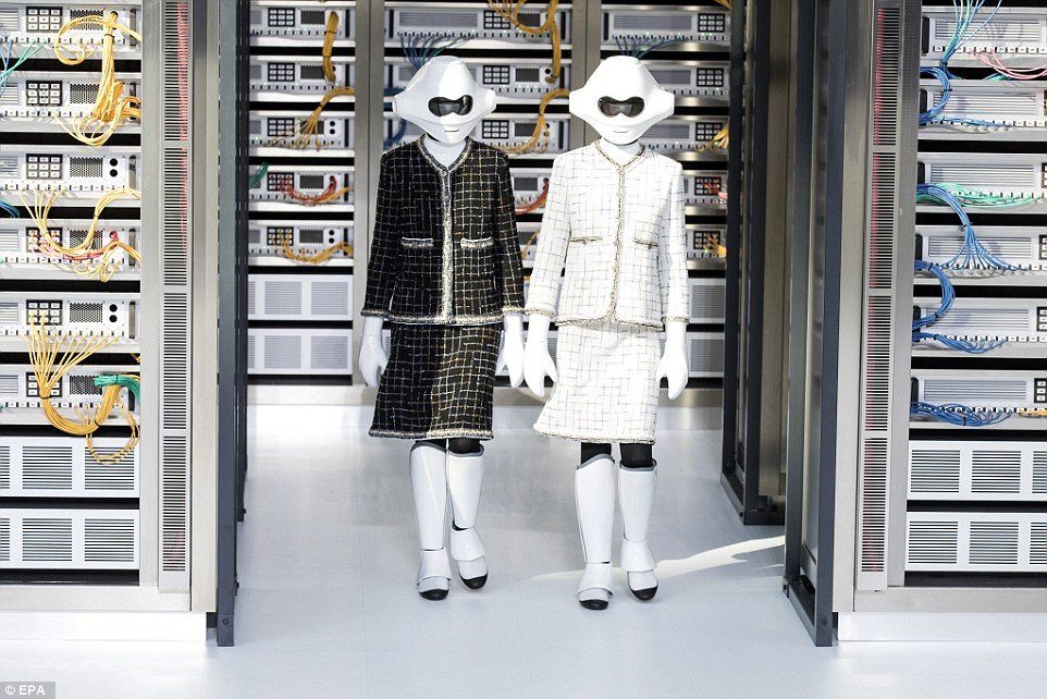 Two Storm trooper-esque models took to the runway in Karl's iconic black and white tweed jackets and skirts with the huge data centre as a backdrop