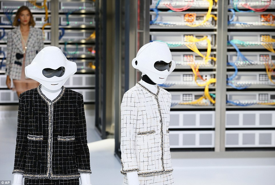 Models - including Arizona Muse and hot-right-now Taylor Hill - wore cyborg-like white helmets and shin guards with their impeccable tweed Chanel outfits