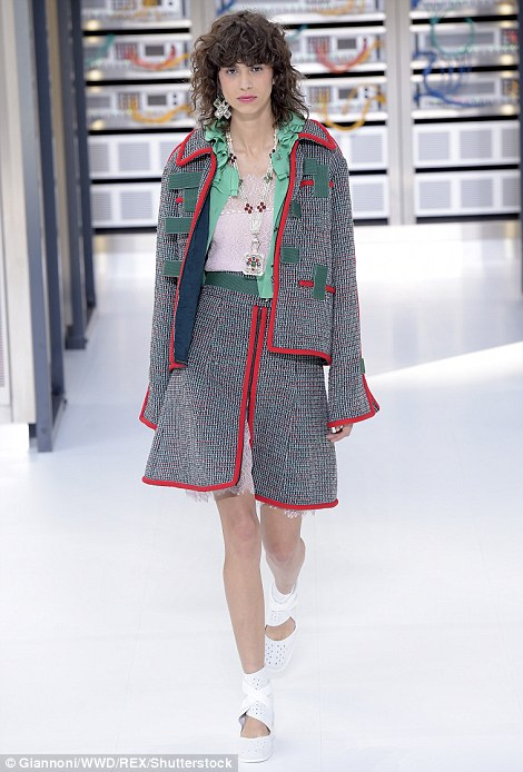Karl, who has a knack for reinventing his iconic Chanel tweed suit season after season, went back to basics with a classic navy, grey and white boucle jackets taking centre stage but injected them with flashes of silver in line with the technological theme