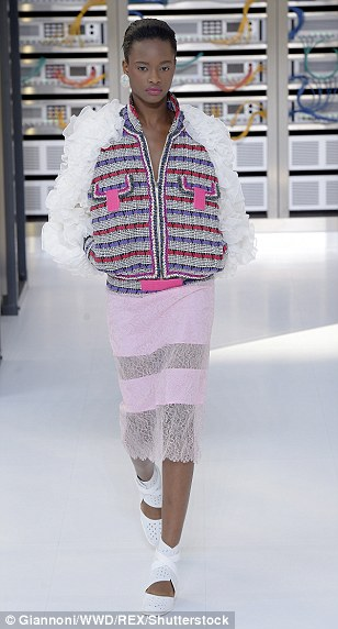 Karl's clothes for next summer consist of sheer panelled lace skirts and voluminous bomber jackets