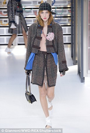 As well as slanted baseball caps, accessories included 80s-inspired medallions hung on Chanel lanyards