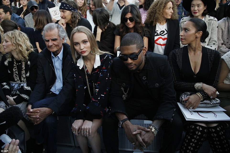 From left, Patrick Demarchelier, Lily Rose Depp, and Usher  wait prior to the show kicking off