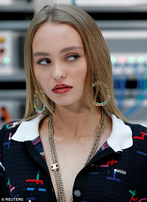 Lily Rose Depp showed off her natural beauty as she posed ahead of the star-studded show