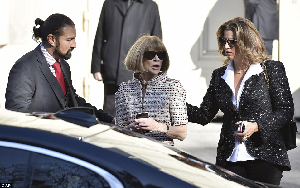 U.S Vogue editor in chief Anna Wintour, center,  leaves after the presentation with Roger Federer's wife