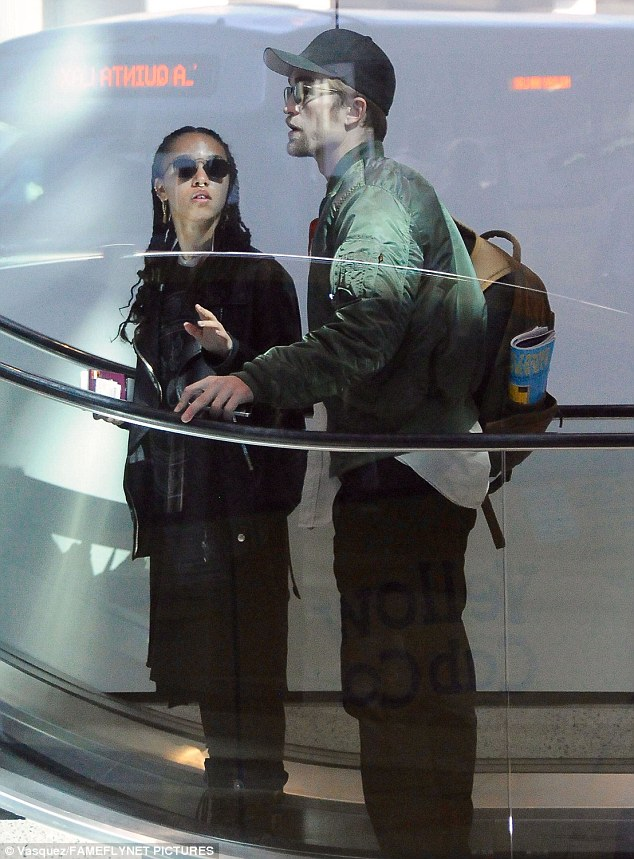 In line: Robert Pattinson and girlfriend FKA Twigs were afforded no special treatments as the made their way through security at LAX on Monday