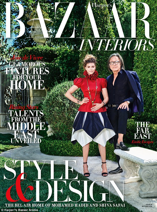Showing it off: The couple appears on the cover posing proudly outside the home