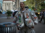 Rob Greenfield, an environmental activist who is spending a month in New York, has hanging on himself all the trash he's produced in ziplog bags on October 4, 2016 in New York ©Bryan R. Smith (AFP)