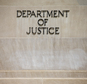In this photo taken June 19, 2015, the Justice Department Building in Washington. A federal government contractor has been accused of removing highly classified information and storing the material in his house and car, federal prosecutors announced Wednesday, Oct. 5, 2016. The Justice Department announced a criminal complaint against Harold Thomas Martin III of Glen Burnie, Maryland. (AP Photo/Andrew Harnik)