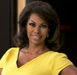 """FILE - In this April 28, 2015, file photo, Fox News anchor Harris Faulkner poses for a photo on the set in New York. Faulkner's lawyer said Wednesday, Oct. 5, 2016, that she settled a $5 million lawsuit against Hasbro over a toy hamster bearing her name. Faulkner sued the Pawtucket, R.I., toy company in 2015 over a toy in its Littlest Pet Shop line. Her lawyer said the toy is no longer sold and the lawsuit was """"settled amicably."""" (AP Photo/Richard Drew, File)"""