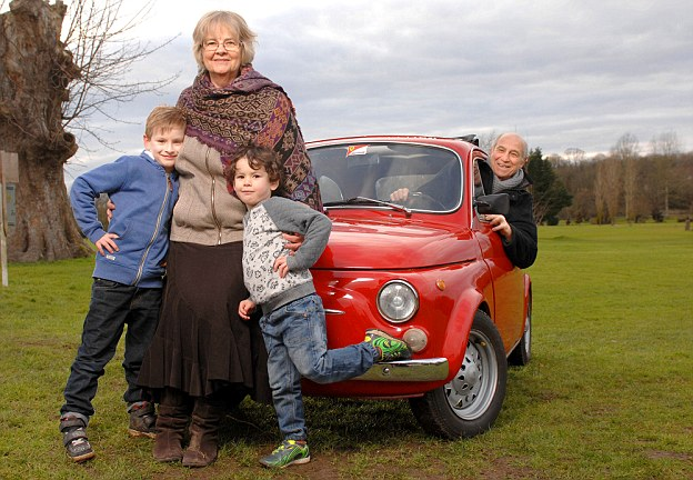 Fears: Jenny Squillaci, pictured with her husband Vittorio and grandsons Luca and Leo, says future generations will suffer