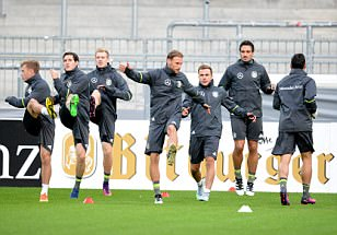 Mesut Ozil, Manuel Neuer and Thomas Muller are put through their paces as Germany coach