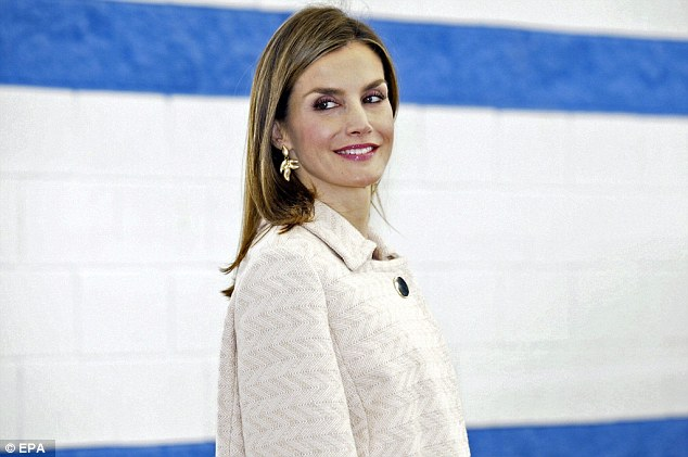 Yesterday Queen Letizia of Spain covered up her famously slender frame today in a loose fitting cape as she arrived at a secondary school in the town ofMondonedo
