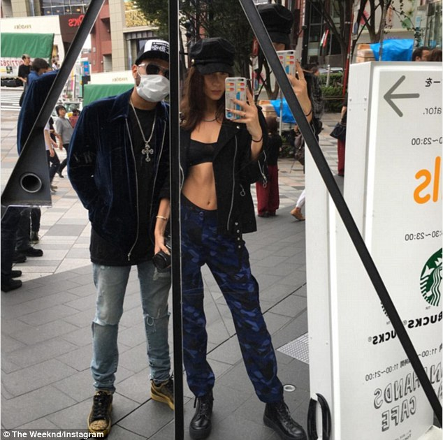 Masked man: The Weeknd shared a rare selfie with his girlfriend of over a year, Bella Hadid, during a romantic trip to Japan on Wednesday