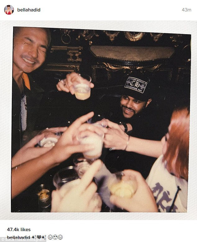Glasses up: The Weeknd toasted with some locals