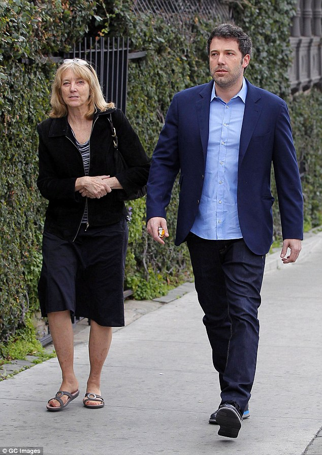 On their side: One person who's rooting for a Ben and Jen marriage comeback is Affleck's mom Christine Boldt (pictured with him in 2014)