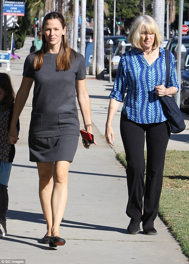 Close ties: Jennifer clearly adores her mother-in-law (pictured with her last November) but is 'torn' about stalling divorce proceedings