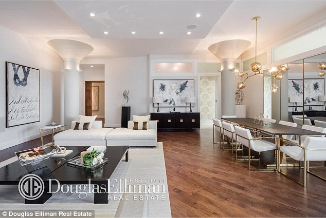 Dream home: The swanky 3,600 sq ft apartment, which features an open plan living and dining area with extravagant columns, is in the much sought after Tribeca neighbourhood