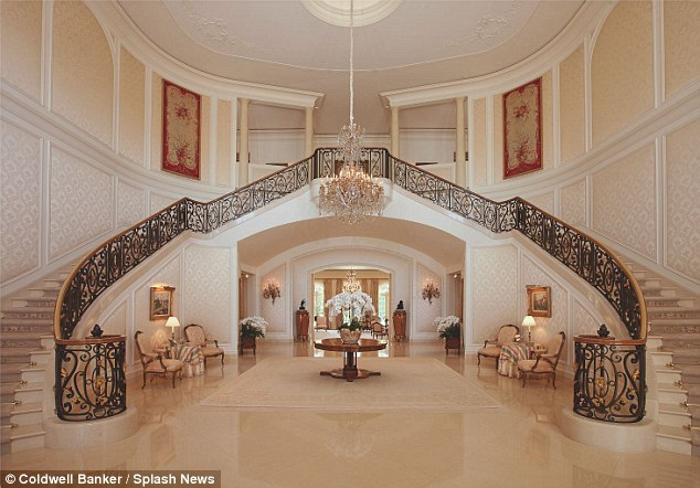 Welcome:The luxurious home boasts 14 bedrooms and 27 bathrooms, a tennis court and an orchard over 56,500 square feet, making it one of the more desirable properties in its exclusive west Los Angeles neighbourhood