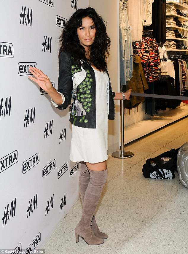 Top Chef in taupe: Padma's thigh-high boots set off her slender figure perfectly