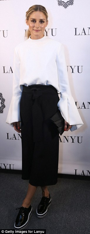 Trendsetters: Olivia Palermo, 30, donned a white Lan Yu top with exaggerated bell sleeves to NYFW