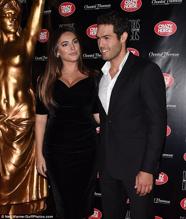 Happy together: The former glamour model has been dating the judo pro for over a year