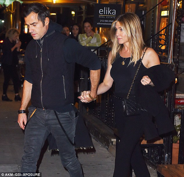 Refusal: The Mother's Day star (pictured with husband Justin Theroux on September 24) is said to have refused to take her mom's ashes too after the memorial, In Touch also reported