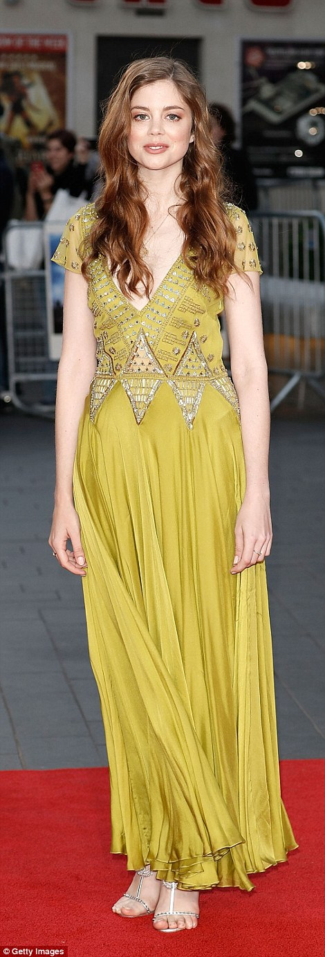 Boho beauty: Charlotte Hope rocked the red carpet in a mustard coloured number with mirrored detailing