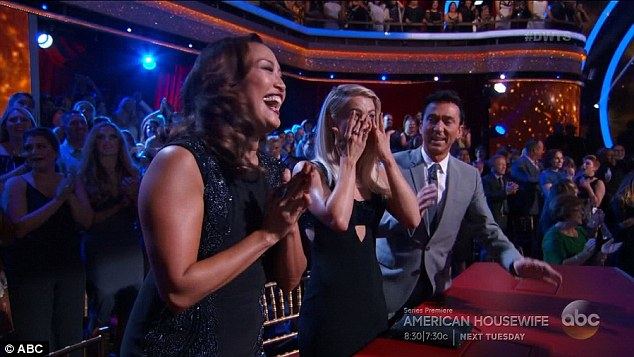 Getting emotional: Julianne Hough wiped away tears after the proposal as Carrie Ann Inaba and Bruno Tonioli looked on