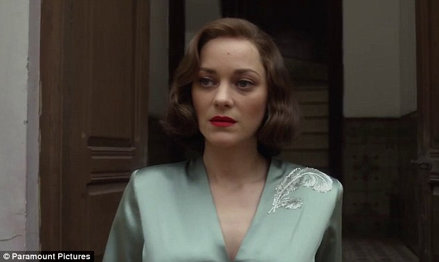 The trailer opens with French actress Cotillard walking towards an open door in a silky evening gown