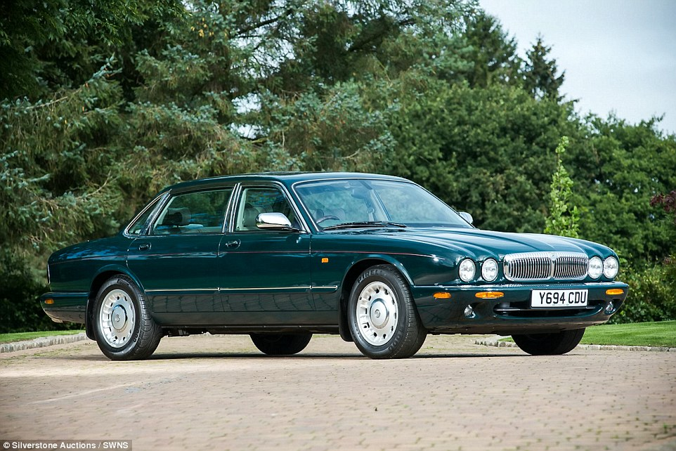 The Queen's 2001 Daimler Supercharged V8 should sell for around £60,000 at the Silverstone Auctions' Classic Motor Show Sale at Birmingham's National Exhibition Centre on November 12 and 13. The Queen travelled more than 11,000 miles in the car and it features a number of unique modifications including a factory adapted armrest with a sliding holder specifically designed to hold her particular type of handbag