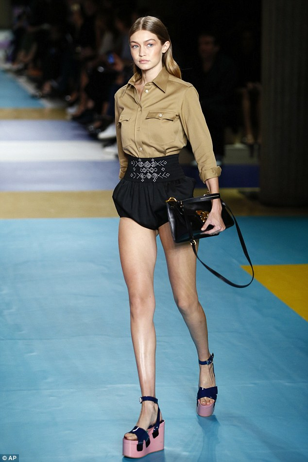Catwalk queen: Gigi Hadid marked the last day of Paris Fashion Week with a strut down the Miu Miu catwalk on Wednesday
