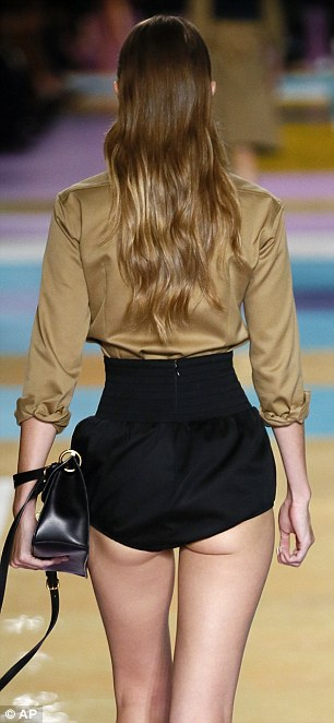 Curvy: Gigi showed off her trim waist in the hotants and silky shirt tucked in