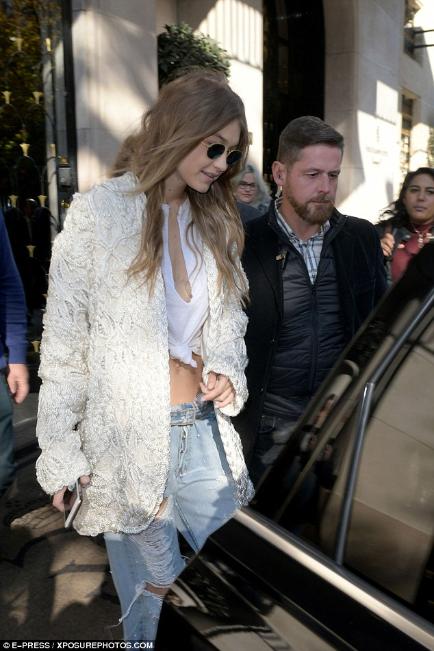 All white! Atop her low-key ensemble was a thick knit white cardigan style jacket adorned with heavy rope details. She also wore a pair of box-fresh Reebok trainers, a natural choice given her recent deal with the sporting giant
