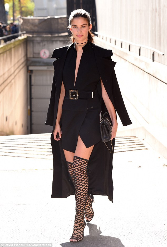Kinky boots: Sara Sampaio made a sartorial statement as she arrived at the Miu Miu SS17 Paris Fashion Week show in the French capital on Wednesday prior to her catwalk appearance