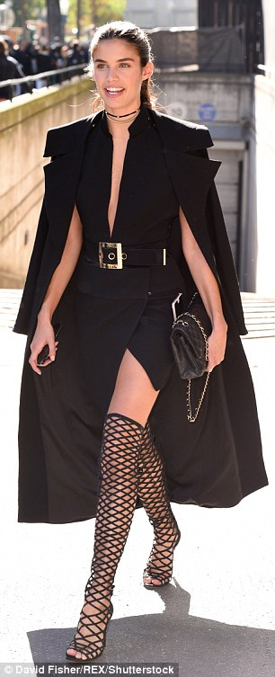 These boots were made for... flaunting: Rocking a rather racy pair of boots, the model, 25, showcased her toned pins in her daring thigh-high caged footwear