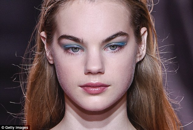 Pro tip: Applying a glossy product like Elizabeth Arden Eight Hour Cream over bright eye make-up (seen here at Nina Ricci's spring show) makes it more wearable