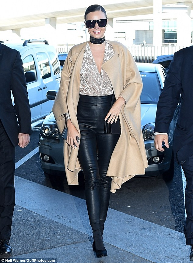 Model on the move: Miranda Kerr, 33, proved she even flies in style as she arrived at Paris Charles De Gaulle airport on Wednesday to head to London 24 hours after touching down